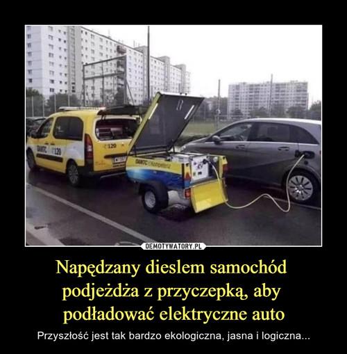 Napędzany dieslem samochód  podjeżdża z przyczepką, aby  podładować elektryczne auto